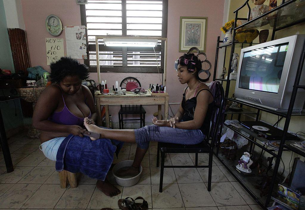 <p>Carmen Gonzalez (R) has her feet pedicured as she prepares for her quinceanera (coming-out for 15-year-olds) celebration.</p>