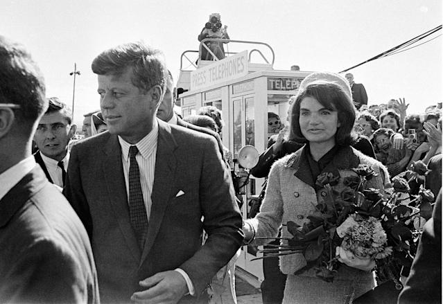 <p>President John F. Kennedy and his wife Jacqueline Kennedy are greeted by an enthusiastic crowd upon their arrival at Dallas Love Field, on Nov. 22, 1963. Only a few hours later, the president was assassinated while riding in an open-top limousine through the city. (Photo: AP) </p>