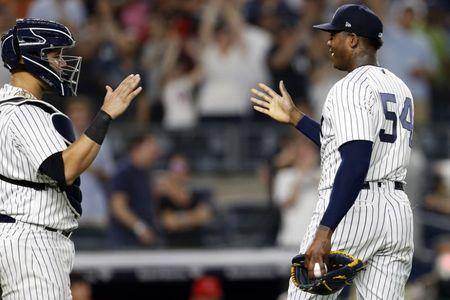 May 25, 2018; Bronx, NY, USA; New York Yankees relief pitcher Aroldis Chapman (54) celebrates with Yankees catcher Gary Sanchez (24) after defeating the Los Angeles Angels at Yankee Stadium. Mandatory Credit: Adam Hunger-USA TODAY Sports