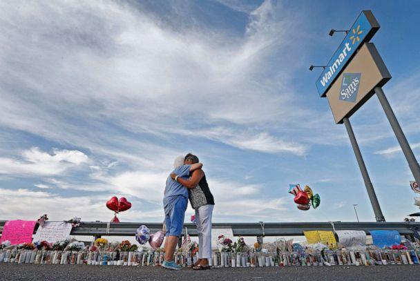 PHOTO: Two women hug while attending the make shift memorial along the street after the mass shooting at a Walmart in El Paso, Texas, Aug. 5, 2019. (Larry W. Smith/EPA via Shutterstock)
