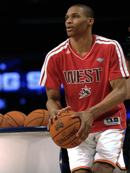 CORRECTS TO SHOOTING STARS CONTEST, NOT SKILLS CHALLENGE- Russell Westbrook of the Oklahoma City Thunder participates in the shooting stars contest during NBA All-Star Saturday Night basketball in Houston on Saturday, Feb. 16, 2013. (AP Photo/Pat Sullivan)
