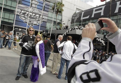 Los Angeles Kings fans Justin Bran, left, and Amelia Cline pose for a photo outside the Staples Center before Game 3 of the Stanley Cup Finals against the New Jersey Devils, Monday, June 4, 2012, in Los Angeles. (AP Photo/Jae C. Hong)