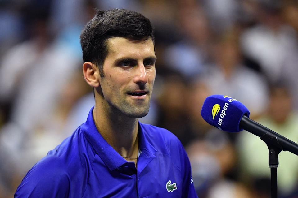 Serbia's Novak Djokovic speaks on the court after winning his 2021 US Open Tennis tournament men's singles first round match against Denmark's Holger Rune at the USTA Billie Jean King National Tennis Center in New York, on August 31, 2021. (Photo by ANGELA  WEISS / AFP) (Photo by ANGELA  WEISS/AFP via Getty Images)