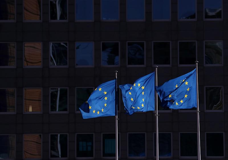 European Union flags fly outside the European Commission headquarters in Brussels, Belgium, February 19, 2020. REUTERS/Yves Herman