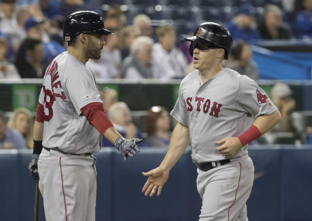 Boston Red Sox's Brock Holt comes in to score on a single by Xander Bogaerts during the seventh inning against the Toronto Blue Jays in a baseball game Thursday, Sept. 12, 2019, in Toronto. (Fred Thornhill/The Canadian Press via AP)