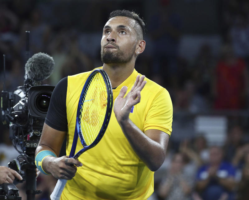 Nick Kyrgios of Australia reacts after winning his match against Jan-Lennard Struff of Germany at the ATP Cup tennis tournament in Brisbane, Australia, Friday, Jan. 3, 2020. (AP Photo/Tertius Pickard)