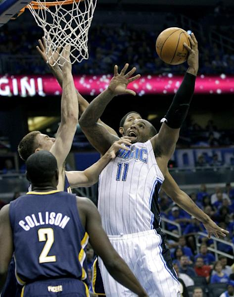 Orlando Magic's Glen Davis (11) goes up for a shot past the Indiana Pacers defense including Darren Collison (2), and Tyler Hansbrough, back left, during the first half of Game 3 of an NBA first-round playoff basketball series, Wednesday, May 2, 2012, in Orlando, Fla. (AP Photo/John Raoux)
