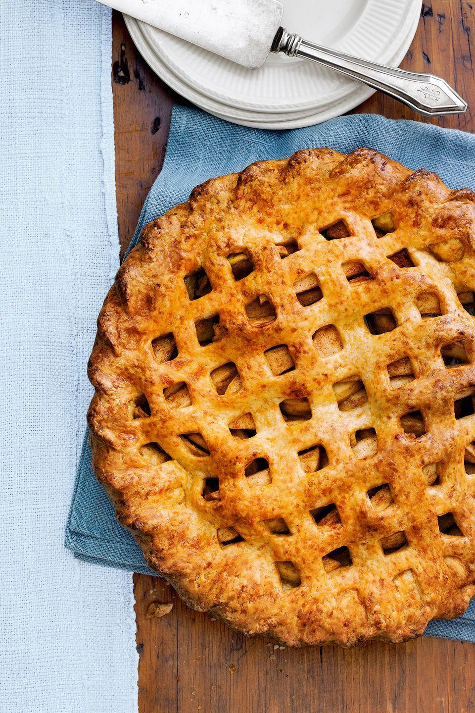 "<p>Make this the year you finally master that gorgeous <a href=""https://www.countryliving.com/food-drinks/g937/perfect-pie-crust-0410/"" rel=""nofollow noopener"" target=""_blank"" data-ylk=""slk:lattice top"" class=""link rapid-noclick-resp"">lattice top</a>. </p><p><strong><a href=""https://www.countryliving.com/food-drinks/recipes/a4247/cheddar-apple-pie-recipe-clx1013/"" rel=""nofollow noopener"" target=""_blank"" data-ylk=""slk:Get the recipe"" class=""link rapid-noclick-resp"">Get the recipe</a>.</strong></p>"