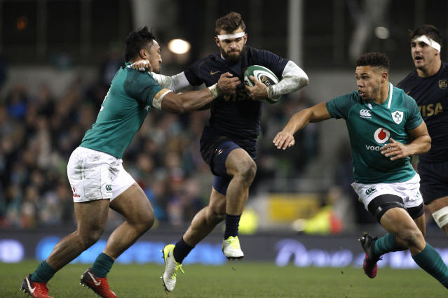 Argentina's Ramiro Moyano, centre, is tackled by Ireland's Bundee Aki, left, during a rugby union international match at the Aviva stadium in Dublin, Ireland, Saturday, Nov. 25, 2017. (AP Photo/Peter Morrison)