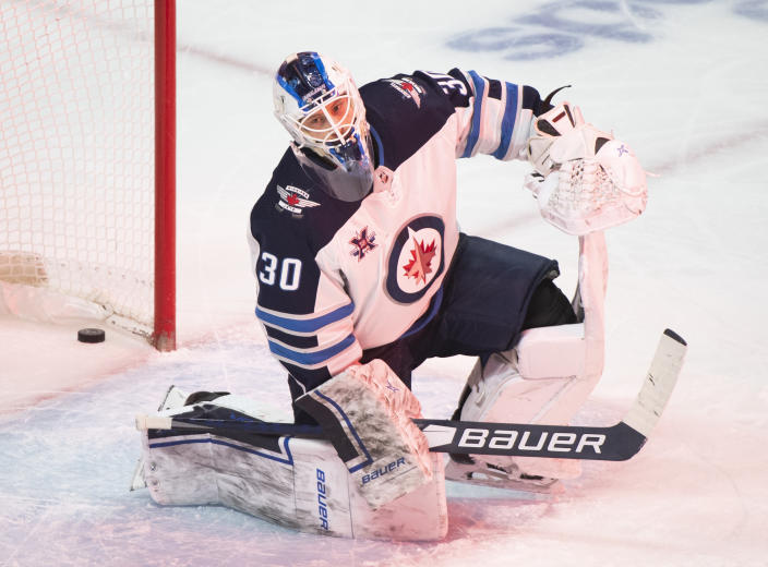 Winnipeg Jets goaltender Laurent Brossoit reacts after giving up a goal to Montreal Canadiens' Jeff Petry during the third period of an NHL hockey game Saturday, March 6, 2021, in Montreal. (Graham Hughes/The Canadian Press vIa AP)