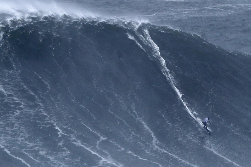 Maya Gabeira from Brazil rides a wave during the Nazare Tow Surfing Challenge at Praia do Norte or North Beach in Nazare, Portugal, Tuesday, Feb. 11, 2020. (AP Photo/Armando Franca)