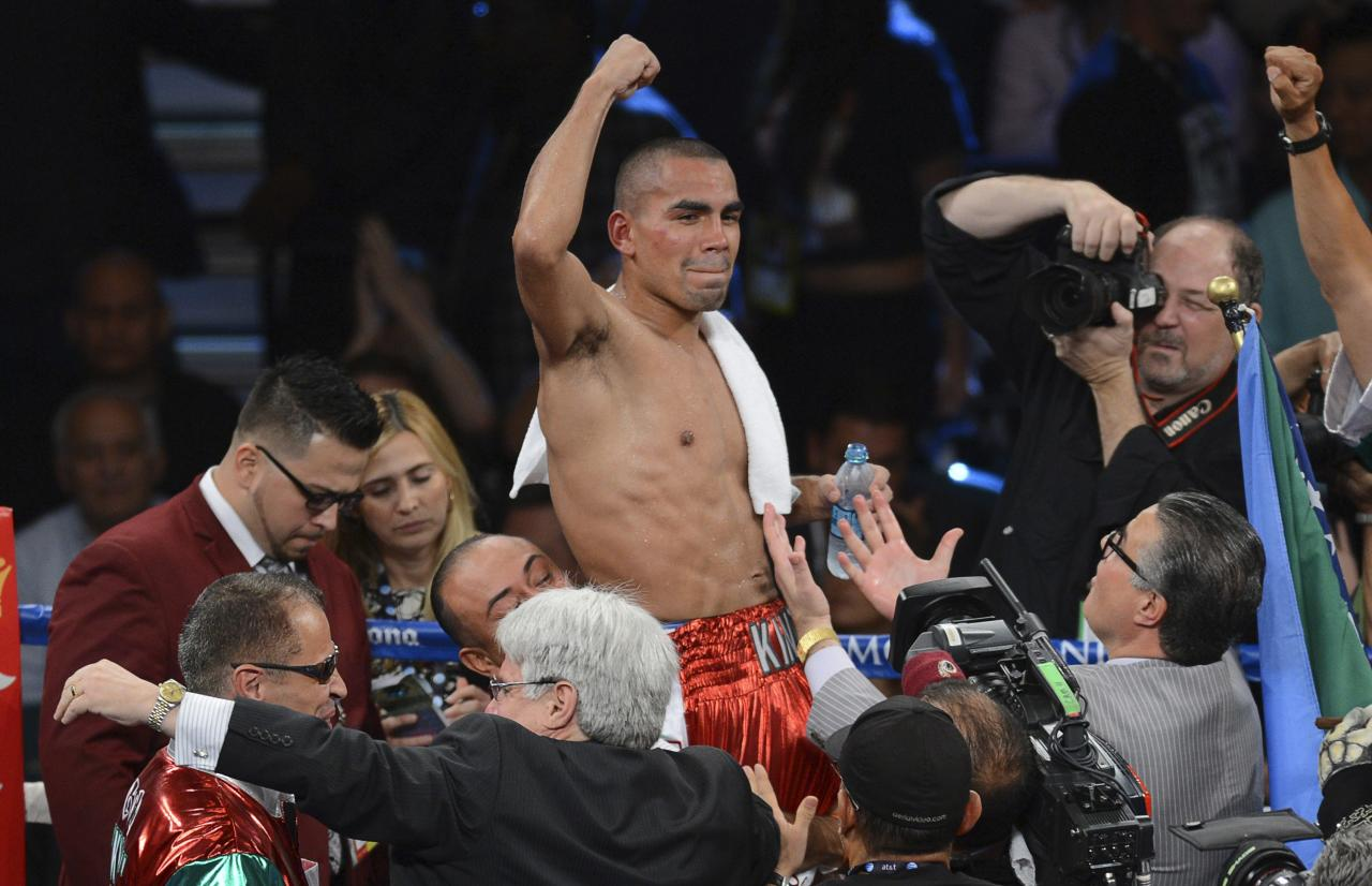 Carlos Molina of Mexico celebrates his victory over IBF junior middleweight champion Ishe Smith of the U.S. at the MGM Grand Garden Arena in Las Vegas, Nevada, September 14, 2013. REUTERS/Mark Hundley (UNITED STATES - Tags: SPORT BOXING)