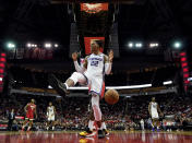 Sacramento Kings' Richaun Holmes (22) reacts after dunking the ball against the Houston Rockets during the second half of an NBA basketball game Monday, Dec. 9, 2019, in Houston. The Kings won 119-118. (AP Photo/David J. Phillip)