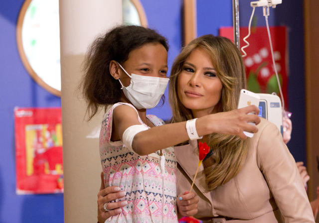<p>A small child takes a selfie with Melania Trump, the wife of US President Donald Trump, at the Queen Fabiola Childrens Hospital in Brussels on May 25, 2017. Melanie Trump visited children in a ward at the hospital on Thursday and participated in a crepe paper flower making workshop. (Photo: Virginia Mayo/AP) </p>