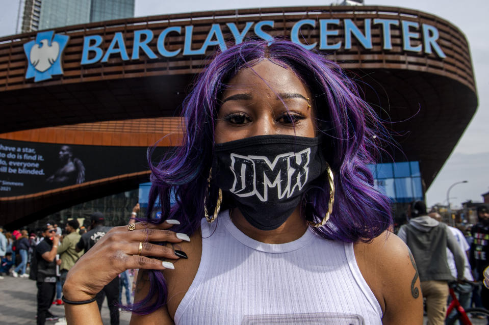 "Cherrelle McClary, 32, poses for a portrait with her DMX mask during a memorial at Barclays Center, Saturday, April. 24, 2021, in the Brooklyn borough of New York. DMX, whose birth name is Earl Simmons, died April 9 after suffering a ""catastrophic cardiac arrest."" (AP Photo/Brittainy Newman)"