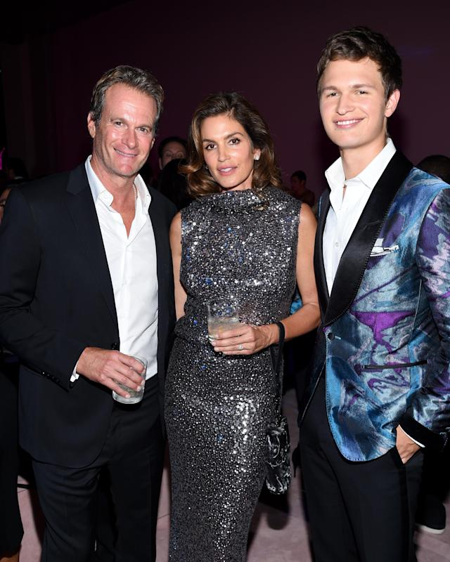 Rande Gerber, Cindy Crawford, and Ansel Elgort at the Tom Ford SS18 show afterparty. (Photo: Getty)