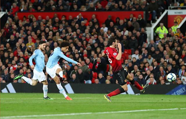 Leroy Sane of Manchester City scores his team's second goal during the Premier League match between Manchester United and Manchester City