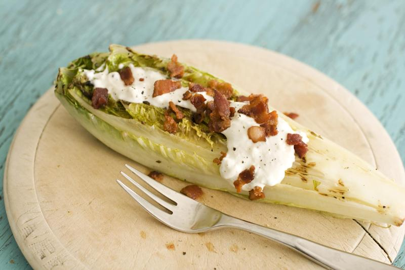 In this image taken on May 13, 2013, grilled hearts of romaine with blue cheese dressing are shown in Concord, N.H. (AP Photo/Matthew Mead)