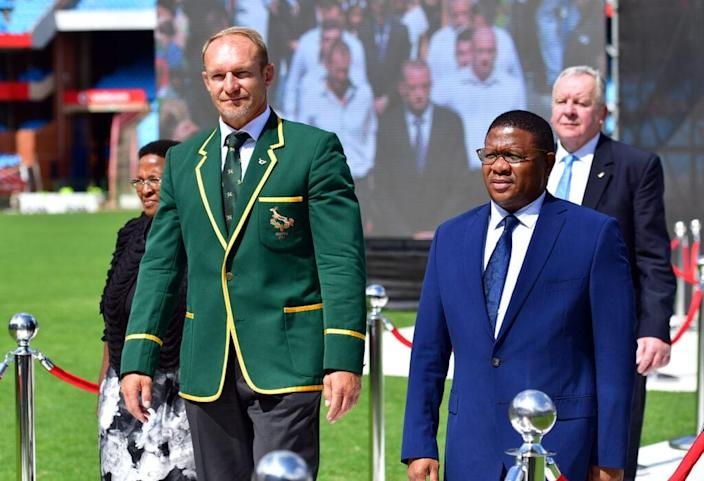 Francois Pienaar, who took a knee in support of Black people, and Fikile Mbalula during the Memorial service of Joost van der Westhuizen at Loftus Versfeld on February 10, 2017 in Pretoria, South Africa. (Photo by Johan Rynners/Gallo Images/Getty Images)