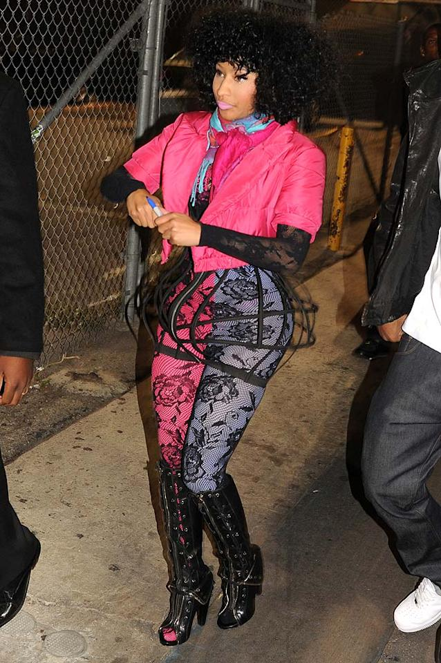 """Ah, the horrendous black lace trend continues ... as does Nicki Minaj's weekly appearance in What Were They Thinking?! The colorful rapper earned another spot in our fashion faux pas gallery thanks to the cropped pink puffer coat, lacy jumpsuit, and an unnecessary cage skirt she was spotted wearing in Hollywood after making an appearance on """"Jimmy Kimmel Live!"""" C Seavey/<a href=""""http://www.splashnewsonline.com/"""" target=""""new"""">Splash News</a> - July 23, 2010"""