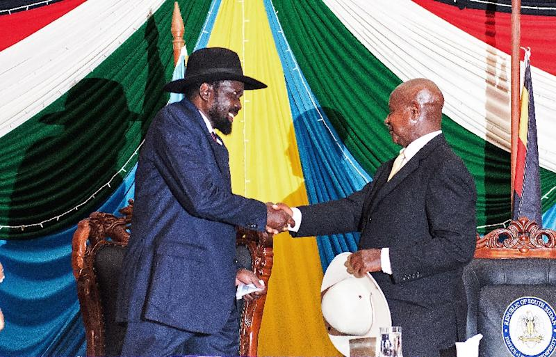 South Sudan's President Salva Kiir (L) shakes hands with Uganda's President Yoweri Museveni after signing a peace agreement to end 20 months of war in the world's youngest nation, in Juba on August 26, 2015