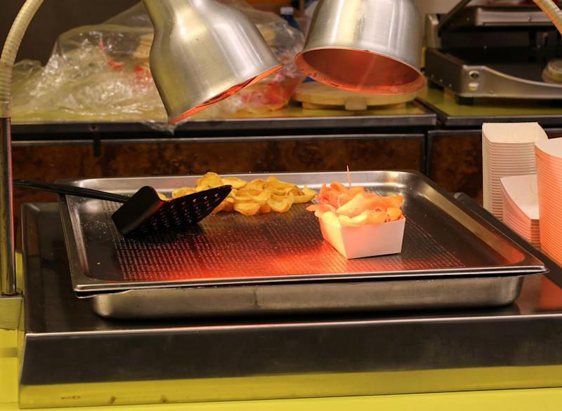 Food french fries under heat lamp
