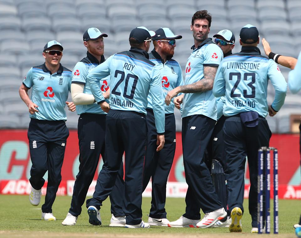 England bowler Reece Topley (2nd r) is congratulated by team mates after  taking the wicket of India batsman Shikhar Dhawan during the 2nd One Day International between India and England at MCA Stadium on March 26, 2021 in Pune, India. (Photo by Surjeet Yadav/Getty Images)