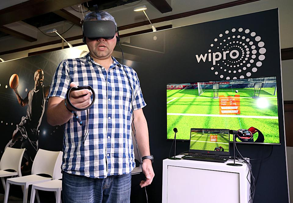 BURBANK, CALIFORNIA - JUNE 22: Guests interact with the Wipro Fan Engagement Experience demo at AT&T SHAPE at Warner Bros. Studios on June 22, 2019 in Burbank, California. (Photo by Phillip Faraone/Getty Images for AT&T)