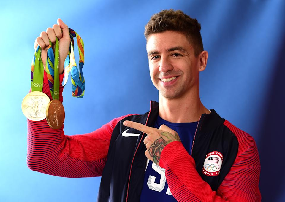 RIO DE JANEIRO, BRAZIL - AUGUST 13:  (BROADCAST - OUT) Swimmer, Anthony Ervin of the United States poses for a photo with his two gold medals on the Today show set on Copacabana Beach on August 13, 2016 in Rio de Janeiro, Brazil.  (Photo by Harry How/Getty Images)