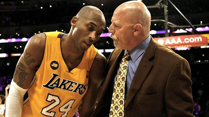 Trainer Gary Vitti talks to an exhausted Kobe Bryant.