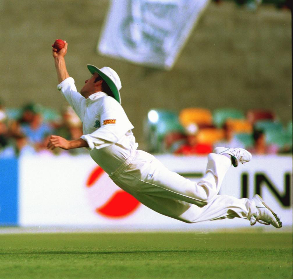 27 NOV 1994:  ENGLAND FIELDER CRAIG WHITE EXECUTES A FANTASTIC DIVING CATCH TO TAKE THE WICKET OF STEVE WAUGH OF AUSTRALIA  OFF THE BOWLING OF PHIL TUFNELL FOR SEVEN RUNS DURING THE THIRD DAY's PLAY IN THE FIRST TEST MATCH OF THE ASHES TOUR AT THE GABBAIN BRISBANE, AUSTRALIA. Mandatory Credit: Ben Radford/ALLSPORT