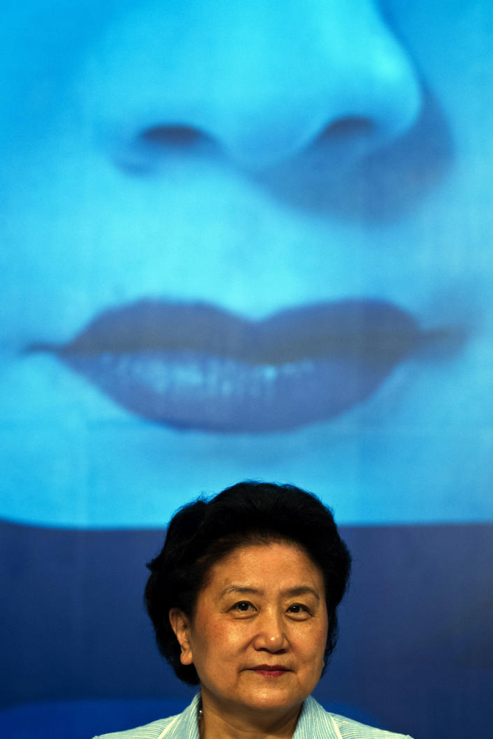 FILE - In this file photo taken Wednesday, June 20, 2012, Chinese State Councilor Liu Yandong attends the opening ceremony for the Diplomatic Conference on the Protection of Audiovisual Performances in Beijing, China. A glance at history suggests it's easier for a Chinese woman to orbit Earth than to land a spot on the highest rung of Chinese politics. In June, the 33-year-old Air Force major marked a major feminist milestone by becoming the first Chinese woman to travel in space. With a once-a-decade leadership transition set to kick off Nov. 8, many now are waiting to see if another ambitious Chinese female, State Councilor Liu Yandong, can win one of the nine spots at the apex of Chinese power.(AP Photo/Alexander F. Yuan, File)