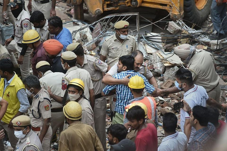 """<div class=""""paragraphs""""><p>New Delhi: NDRF and police personnel during a rescue operation after a building collapsed at Sabji Mandi area in New Delhi on Monday, 13 September.</p></div>"""