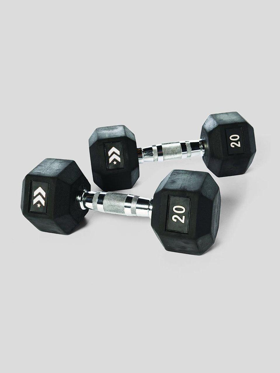 """<p>barrys.com</p><p><strong>$78.00</strong></p><p><a href=""""https://shop.barrys.com/products/barrys-rubber-dumbbell-set?variant=38095320580268"""" rel=""""nofollow noopener"""" target=""""_blank"""" data-ylk=""""slk:Shop Now"""" class=""""link rapid-noclick-resp"""">Shop Now</a></p><p>Gomih is a fan of these weights, which were <strong>designed to be used during HIIT classes</strong> at Barry's. You'll love using them at home—the white numbers make it easy to find the weights you're looking for without having to search through your entire collection. And the handles offer a no-slip grip. </p>"""