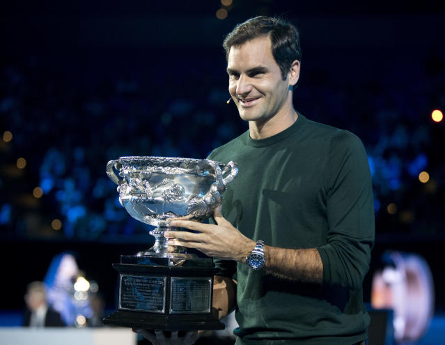 <p> Defending men's singles champion Switzerland's Roger Federer poses for a photo with his trophy during a ceremony for the official draw at the Australian Open tennis championships in Melbourne, Australia Thursday, Jan. 11, 2018. (AP Photo/Mark Baker) </p>