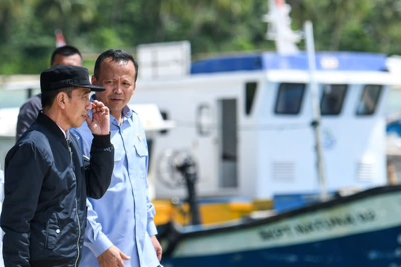Indonesia's President Joko Widodo talks to Indonesia's Maritime Affairs and Fisheries Minister Edhy Prabowo during a visit in Natuna