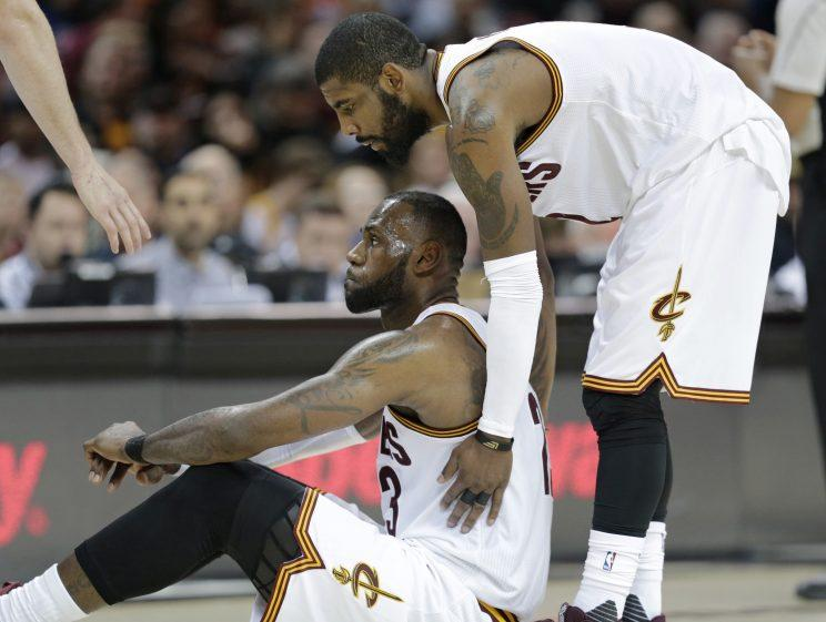 Kyrie Irving and LeBron James in April, before they knew how funny this would look. (AP)