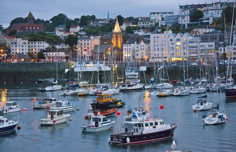Guernsey's St Peter Port harbour in the evening.