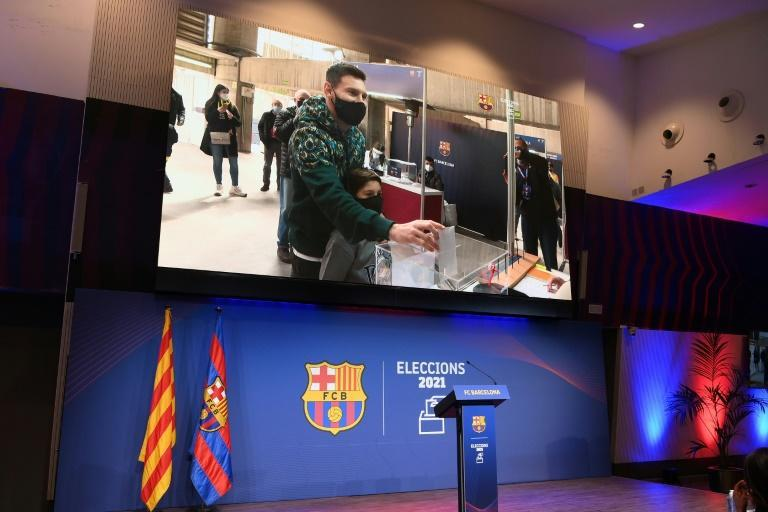 The image of Barcelona's Argentinian forward Lionel Messi voting is displayed at Camp Nou.