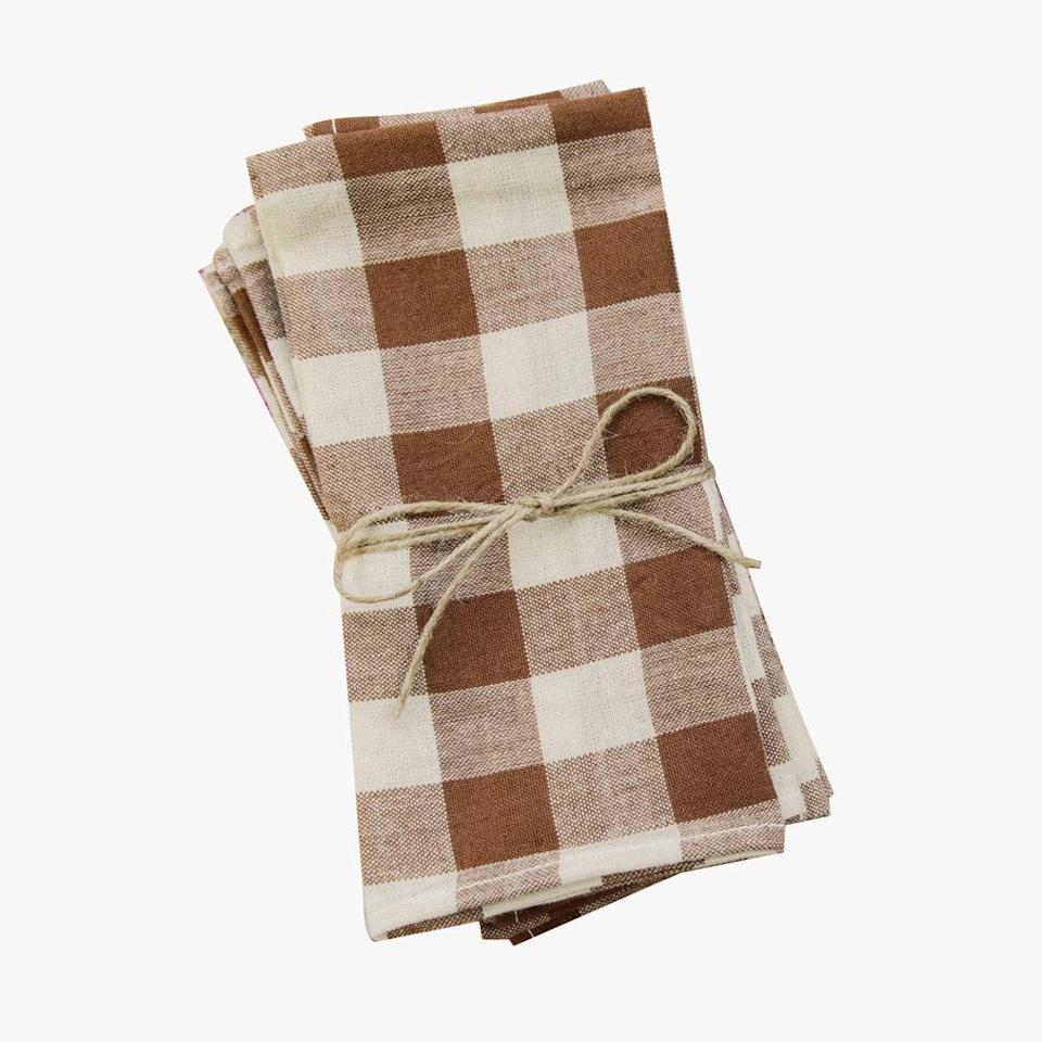 """We love Dôen for their easy dresses. The brand has teamed up with Heather Taylor Home on handwoven cotton napkins ideal for socially-distanced get-togethers. $82, DÔEN. <a href=""""https://shopdoen.com/products/heather-taylor-home-napkins-nutmeg-gingham?"""" rel=""""nofollow noopener"""" target=""""_blank"""" data-ylk=""""slk:Get it now!"""" class=""""link rapid-noclick-resp"""">Get it now!</a>"""