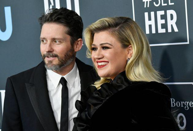 Kelly Clarkson (right) filed for divorce from Brandon Blackstock in June.