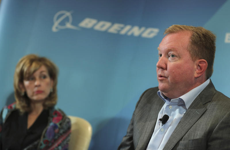 Stan Deal, president and CEO of Boeing Commercial Airplanes, right, talks as Leanne Caret president and CEO of Boeing Defense, Space & Security looks on at the Boeing press conference a day ahead before Dubai Airshow in Dubai, United Arab Emirates, Saturday, Nov. 16, 2019. The senior Boeing executive says the company knows it has to re-earn the public's trust as it works to win approval from U.S. regulators to get its grounded 737 Max jets flying again after crashes that killed 346 people.(AP Photo/Kamran Jebreili)