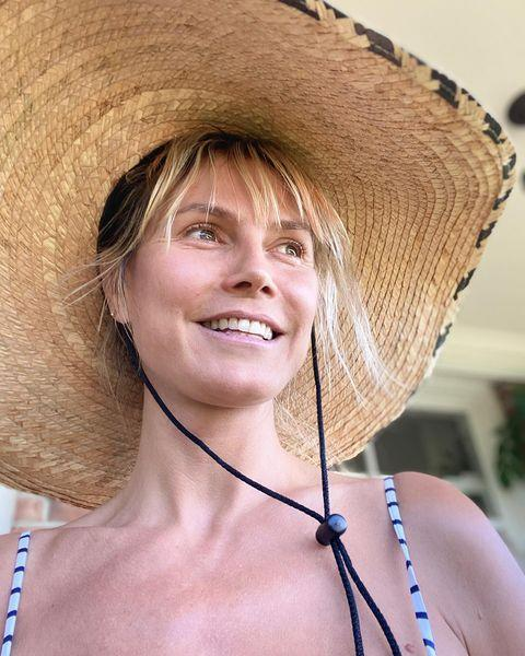 "<p>Supermodel Heidi Klum embraced her au natural side while painting, sporting a wide brim straw hat, stripy bikini and make-up free sun-kissed skin.</p><p><a href=""https://www.instagram.com/p/CDPzno9J3_3/?utm_source=ig_embed&utm_campaign=loading"" rel=""nofollow noopener"" target=""_blank"" data-ylk=""slk:See the original post on Instagram"" class=""link rapid-noclick-resp"">See the original post on Instagram</a></p>"