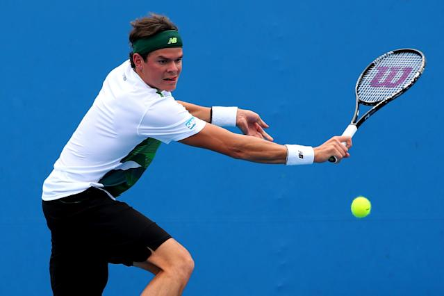 MELBOURNE, AUSTRALIA - JANUARY 17: Milos Raonic of Canada plays a backhand in his second round match against Lukas Rosol of the Czech Republic during day four of the 2013 Australian Open at Melbourne Park on January 17, 2013 in Melbourne, Australia. (Photo by Chris Hyde/Getty Images)