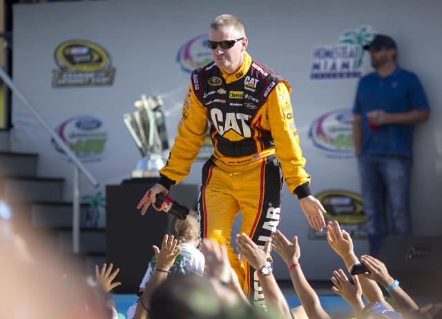 Jeff Burton greets fans during driver introductions before the NASCAR Sprint Cub Series auto race in Homestead, Fla., Sunday, Nov. 17, 2013. (AP Photo/J Pat Carter)