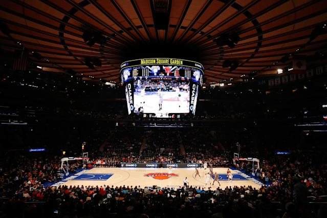 """Madison Square Garden security does not look kindly upon """"Sell the team"""" chants. (Photo by Mike Stobe/Getty Images)"""