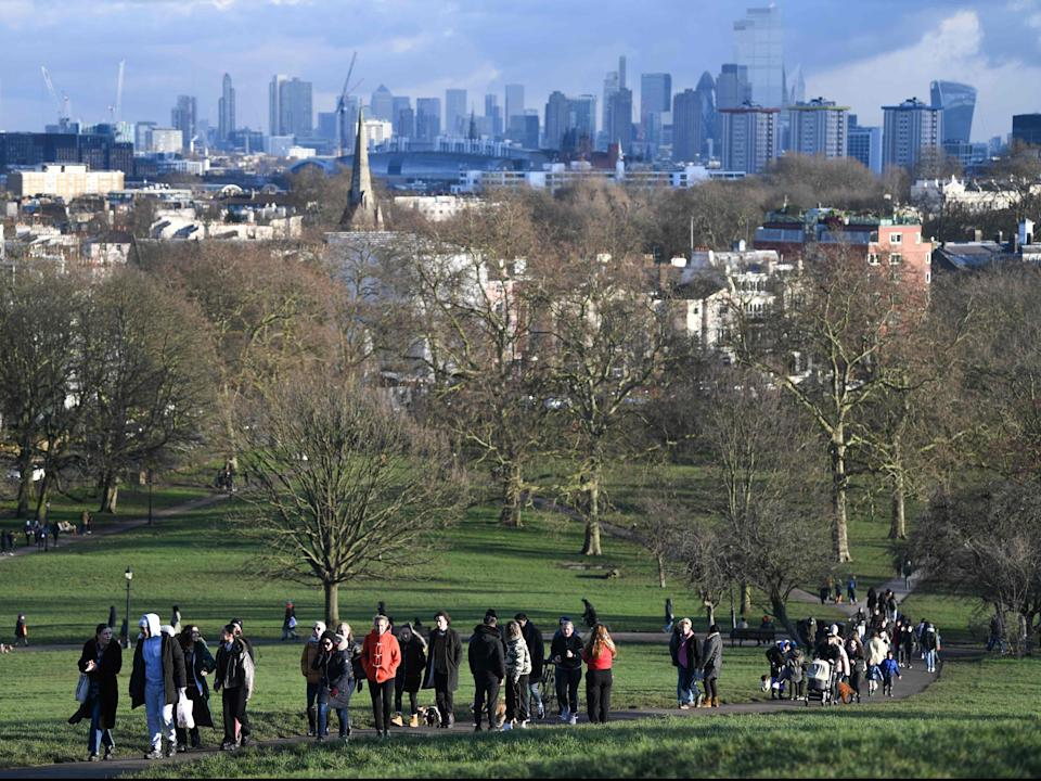 <p>People take daily excercise at Primrose Hill, north London </p> (AFP via Getty)