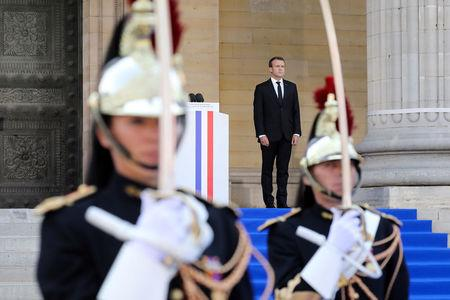 French President Emmanuel Macron stands outside the Pantheon before delivering a speech in tribute to late Auschwitz survivor and French health minister Simone Veil and her late husband Antoine Veil during a national tribute before being laid to rest in the crypt of the Pantheon mausoleum, in Paris, France, July 1, 2018    Ludovic Marin/Pool via Reuters