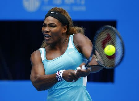 Serena Williams of the U.S. returns the ball during her women's singles match against Silvia Soler-Espinosa of Spain at the China Open tennis tournament in Beijing September 29, 2014. REUTERS/Petar Kujundzic