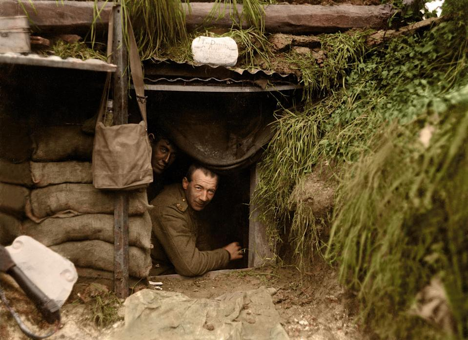 <p>Two New Zealand soldiers look out of a dugout at the front line, Hebuterne in France. (Tom Marshall/mediadrumworld.com) </p>